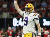 Dec 7, 2019; Atlanta, GA, USA; LSU Tigers quarterback Joe Burrow (9) celebrates his fourth passing touchdown in the third quarter against Georgia Bulldogs in the 2019 SEC Championship Game at Mercedes-Benz Stadium. Mandatory Credit: Jason Getz-USA TODAY Sports