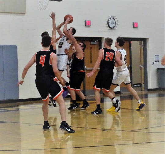 Bloom-Carroll's Monty Lobb shoots over the Amanda-Clearcreek defense duirng the Bulldogs' 44-24 Mid-State League-Buckeye Division win Saturday night.