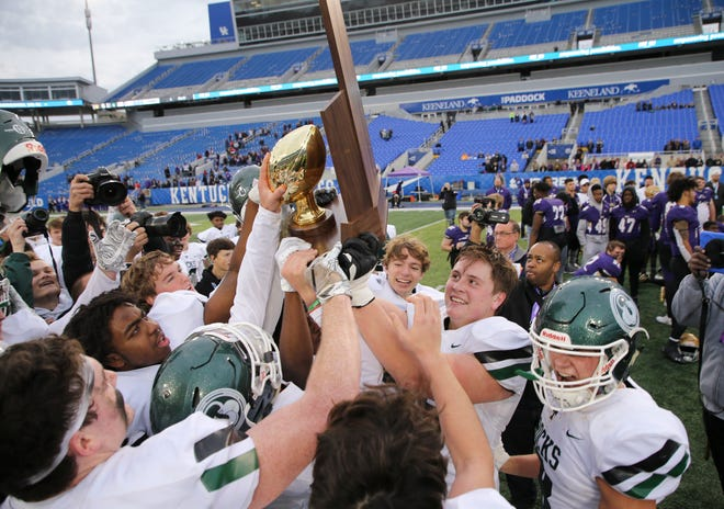 Trinity celebrated after after they defeated Male 28-6 during the 6A state football championship in Lexington, Ky. on Dec. 8, 2019.