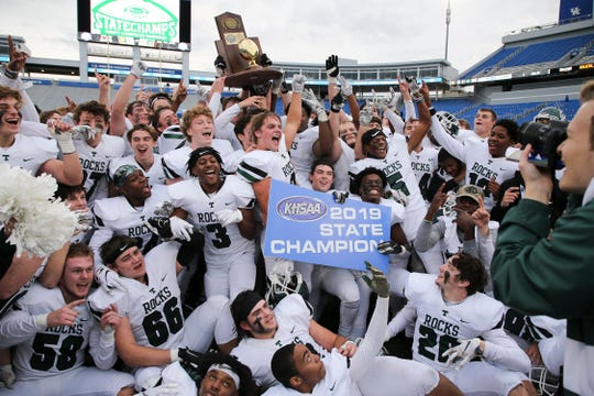 Junior Jackson Schulz (behind #3) and Trinity celebrated after they defeated Male 28-6 during the 6A state football championship in Lexington, Ky. on Dec. 8, 2019.