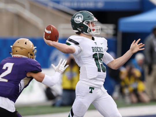 Trinity QB Nathan Mcelroy (15) threw a touchdown pass while under pressure from the Male defense during the 6A state football championship in Lexington, Ky. on Dec. 8, 2019.