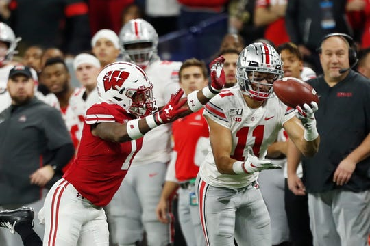 Ohio State's Austin Mack makes a one-handed catch in Saturday's 34-21 victory over Wisconsin.