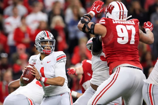 Despite hobbled by an injured left leg, Ohio State quarterback Justin Fields was named MVP of the Big Ten Championship Game