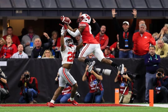 Wisconsin wide receiver Quintez Cephus makes a catch against Ohio State Buckeyes cornerback Cam Brown to set up a touchdown at the end of the first half of the Big Ten title game.
