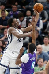 Memphis Grizzlies forward Jaren Jackson Jr. (13) shoots over Utah Jazz guard Emmanuel Mudiay (8) during the first half of an NBA basketball game Saturday, Dec. 7, 2019, in Salt Lake City. (AP Photo/George Frey)