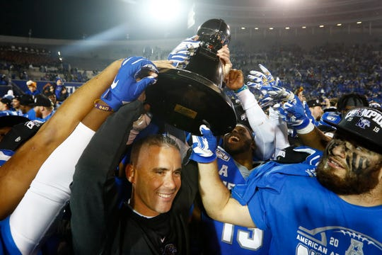 Memphis Tigers Head Coach Mike Norvell celebrates with his players after their 29-24 AAC Championship win over Cincinnati at the Liberty Bowl Memorial Stadium on Saturday, Dec. 7, 2019.