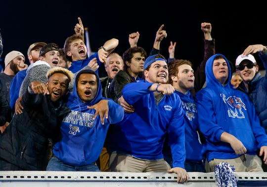 Memphis fans cheer and celebrate their team's touchdown during the AAC Championship game between the Memphis Tigers and Cincinnati Bearcats at Liberty Bowl Memorial Stadium in Memphis, Tenn., on Saturday, Dec. 7, 2019.