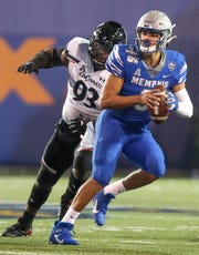 Memphis quarterback Brady White (3) looks for a player to pass to during the AAC Championship game between the Memphis Tigers and Cincinnati Bearcats at Liberty Bowl Memorial Stadium in Memphis, Tenn., on Saturday, Dec. 7, 2019.