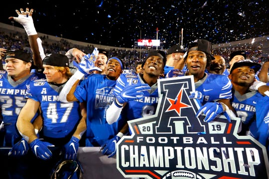 Memphis Tigers players celebrate their 29-24 AAC Championship win over Cincinnati at the Liberty Bowl Memorial Stadium on Saturday, Dec. 7, 2019.
