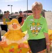 Dottie Weiner, former YMCA swim instructor, puts a hand over her special duck at the 17th Annual Dottie's Duck Derby in 2012 at the Greater Marco Family YMCA.