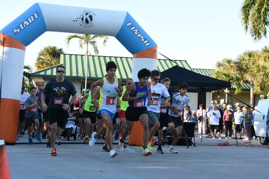 Runners head out through the start/finish arch. The Kiwanis Club of Marco Island held their 7th Annual Marco Island Kiwanis Family 5K race on Saturday, starting and finishing at Tigertail Beach.