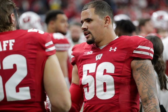 Wisconsin linebacker Zack Baun talks with teammates on the sidelines in the final minutes of the UW-Ohio State game.