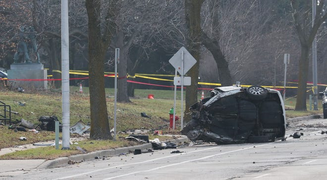 The wreckage from a vehicle police were chasing Sunday morning is strewn across the front lawn of the Milwaukee Safety Academy at 6680 N. Teutonia Ave. The driver and sole occupant of the vehicle was killed.