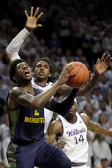 Marquette guard Sacar Anim shoots after getting past Kansas State guard Cartier Diarra during the first half Saturday.