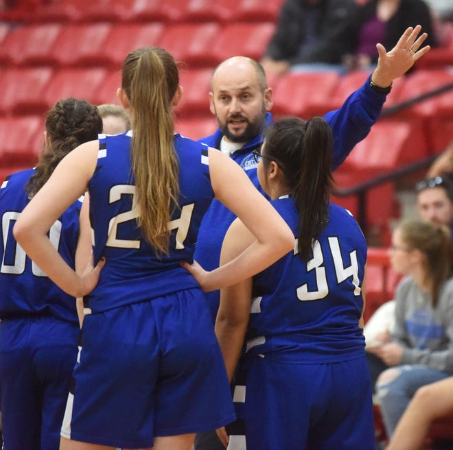 Cotter girls' coach Jared Wilhite instructs his players during a contest earlier this season. The Lady Warriors opened their conference season with a win at Yellville-Summit on Friday night.
