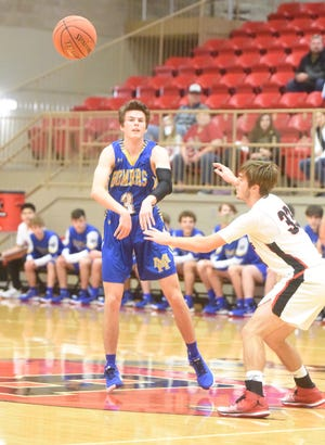 Mountain Home's Jake McGehee passes during the Bombers' 54-48 victory at Branson, Mo., on Saturday night.