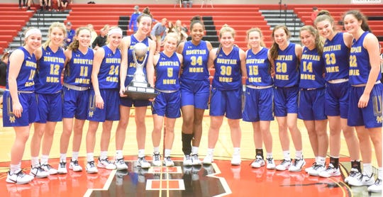 The Mountain Home Lady Bombers captured the championship trophy of the Battle at the Border Tournament in Branson, Mo., on Saturday.