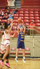 Mountain Home's Emma Martin shoots a baseline jumper against Branson on Saturday.