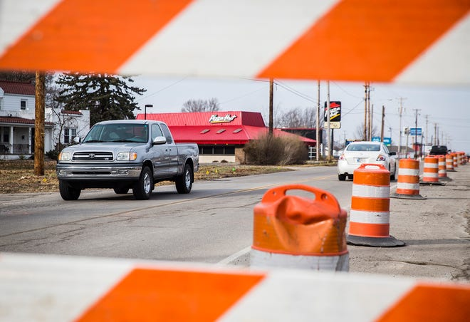 Work continues on Wheeling Avenue north of Centennial Avenue Tuesday.
