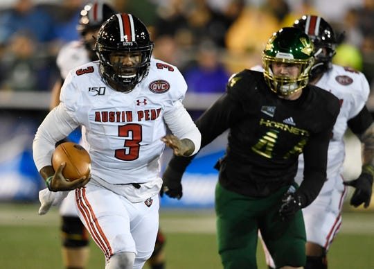 Austin Peay quarterback JaVaughn Craig (3) races up the field for a first down in the first quarter against Sacramento State on Saturday.