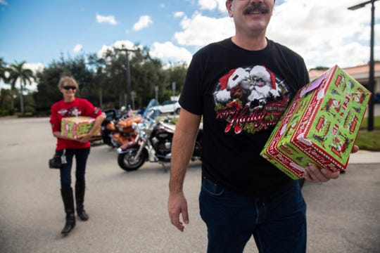 Motorcycle enthusiasts from the Rockstar Hog Chapter donate holiday gifts to pediatric patients on Sunday, December 8, 2019, at North Naples Hospital Pediatric Emergency Department.