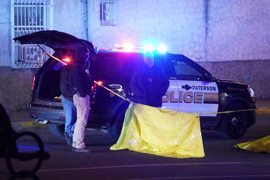 Police at the scene where two people were shot - one fatally - on Ellison Street at Cianci Street in Paterson, NJ around 1:30 a.m. on December 8, 2019. (Photo/Christopher Sadowski)