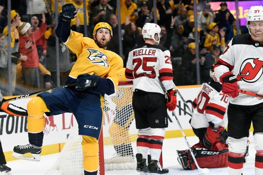 Nashville Predators left wing Filip Forsberg (9), of Sweden, celebrates after scoring against the New Jersey Devils during the second period of an NHL hockey game Saturday, Dec. 7, 2019, in Nashville, Tenn. (AP Photo/Mark Zaleski)
