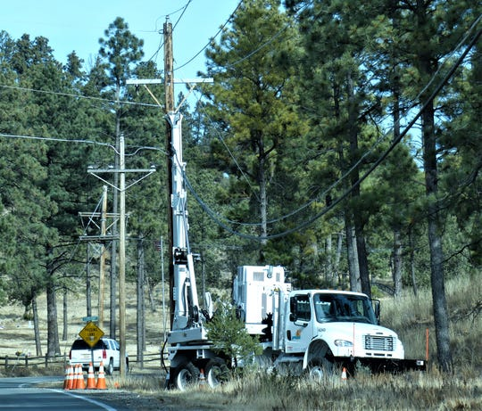 A crew still was working mid-morning Sunday on a new pole to replace the one damaged on Gavilan Canyon.