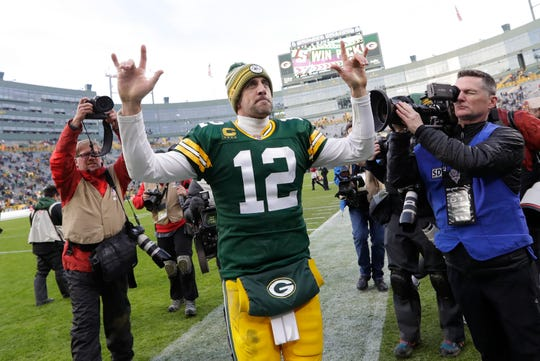 Green Bay Packers quarterback Aaron Rodgers (12) celebrates a victory against the Washington Redskins following their football game Sunday, December 8, 2019, at Lambeau Field in Green Bay,, Wis. 