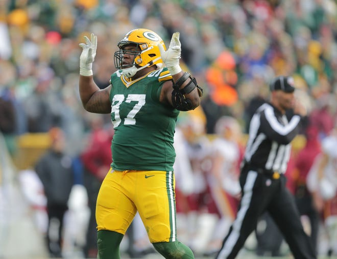 Green Bay Packers nose tackle Kenny Clark (97) celebrates a teammates sack during the 2nd half of the Green Bay Packers 20-15 win over the Washington Redskins at Lambeau Field in Green Bay  on Sunday, Dec. 8, 2019.  Photo by Mike De Sisti/Milwaukee Journal Sentinel