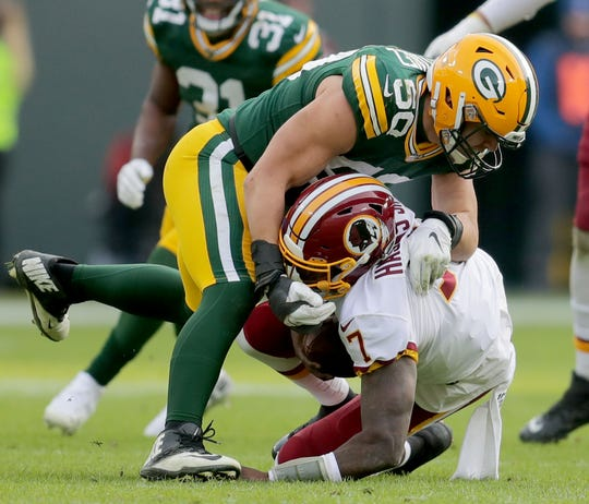 Packers linebackers Blake Martinez sacks Washington quarterback Dwayne Haskins.