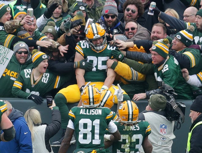 Green Bay Packers tight end Robert Tonyan (85) does the Lambeau Leap after his touchdown during the first half of the Green Bay Packers football game against the Washington Redskins at Lambeau Field in Green Bay  on Sunday, Dec. 8, 2019.  Photo by Mike De Sisti/Milwaukee Journal Sentinel