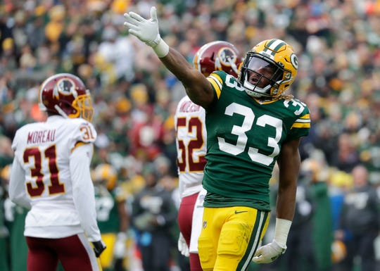 Green Bay Packers running back Aaron Jones (33) celerates after running for a first down against the Washington Redskins during their football game Sunday, December 8, 2019, at Lambeau Field in Green Bay,, Wis. 