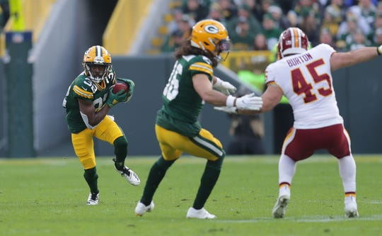 Green Bay Packers running back Tyler Ervin (32) runs a punt back during the 2nd half of the Green Bay Packers 20-15 win over the Washington Redskins at Lambeau Field in Green Bay  on Sunday, Dec. 8, 2019.  Photo by Mike De Sisti/Milwaukee Journal Sentinel