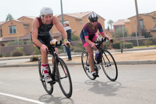 Ironman triathletes participate in the bike portion of the race on December 8, 2019 in La Quinta, Calif.