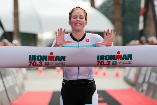 Ironman triathlete, Paula Findlay, celebrates as she crosses the finish line at Indian Wells Tennis Garden on December 8, 2019.