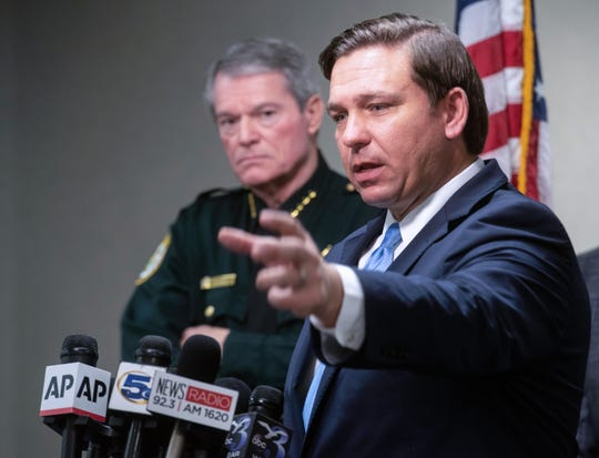 Gov. Ron DeSantis addresses members of the local and national media during a press conference after visiting NAS Pensacola on Sunday, Dec. 8, 2019.