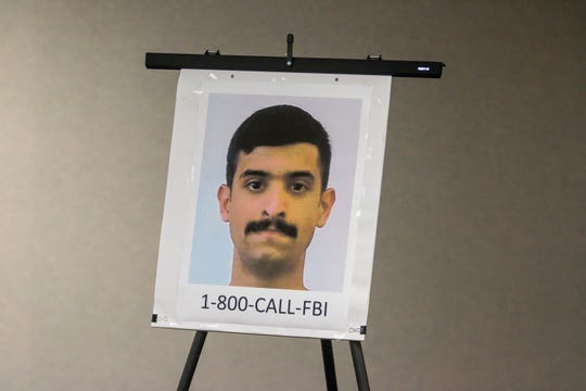 A poster of Mohammed Saeed Alshamrani, confirmed by the FBI as the gunman who killed three and injured eight others on Dec. 6, 2019, at NAS Pensacola, is shown during a press conference on Sunday, Dec. 8, 2019, at the Escambia County Public Safety office. Officials are asking the public for any information they can give on Alshamarani's activities before the attack.