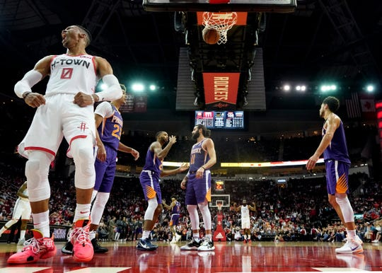 Houston Rockets' Russell Westbrook (0) yells after making a basket while being fouled during the second half of an NBA basketball game against the Phoenix Suns Saturday, Dec. 7, 2019, in Houston. The Rockets won 115-109. (AP Photo/David J. Phillip)