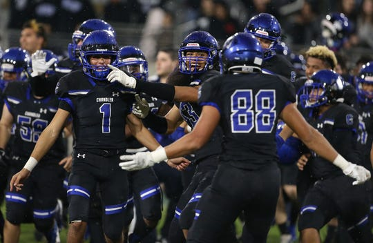 Chandler players celebrates their 42-35 win over Saguaro during the Open Division Championship game at Sun Devil Stadium in Tempe, Sat, Dec 7, 2019.