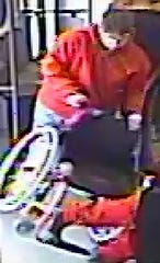 Austin Brett Shurbutt, 26, is seen pushing a woman out of her wheelchair on the light rail in an image taken from a security video on Nov. 29, 2019, police said.