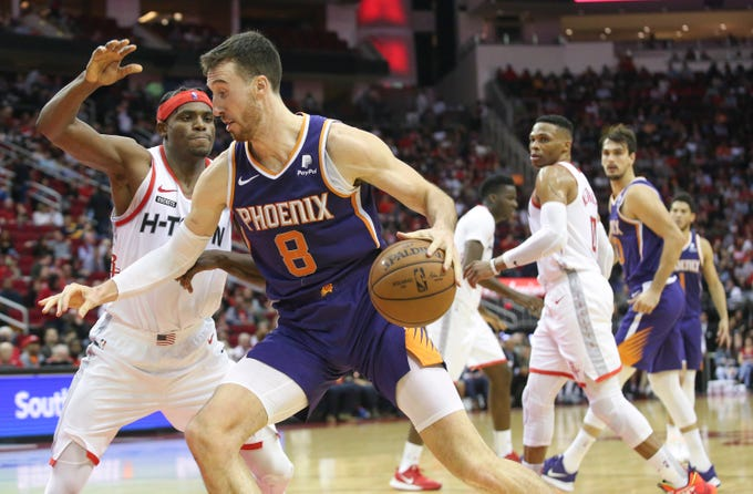 Dec 7, 2019; Houston, TX, USA; Phoenix Suns forward Frank Kaminsky (8) drives the ball against Houston Rockets forward Danuel House Jr. (4) in the second quarter at Toyota Center. Mandatory Credit: Thomas B. Shea-USA TODAY Sports