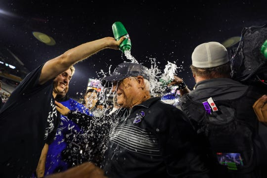 Chandler Head Coach Rick Garretson gets showered with water after defeating Saguaro in the Open Division State Championship on Dec. 7, 2019 in Tempe, AZ.