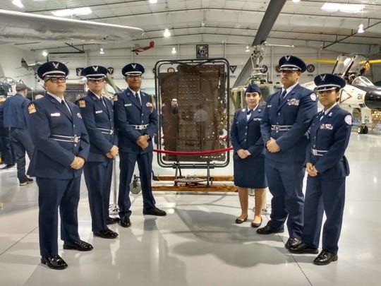 From left: Armando Martinez, Rhett Crandall, Yoshua Uribe, Belle Jackson, Samuel Flores and Melanie Lopez Escalona pose for a photo in front of the piece of steel from the USS Arizona that was unveiled at the Airbase Arizona Museum in Mesa on Dec. 7, 2019.