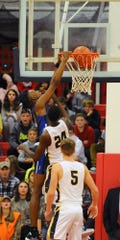 Cedar Crest's Illeri Ayo-Faleye throws down a dunk over Elco's Asher Kemble.