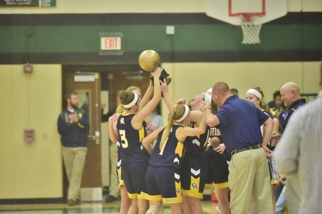 The Greencastle-Antrim girls basketball team celebrates a championship win at the 2019 Franklin County Tip Off Tournament at James Buchanan High School.