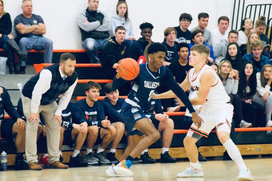 Dallastown's Kobe Green, center, drives past Camden Brewer during the championship game at York Suburban on Saturday. Green led Dallastown with 20 points in the 69-58 victory.
