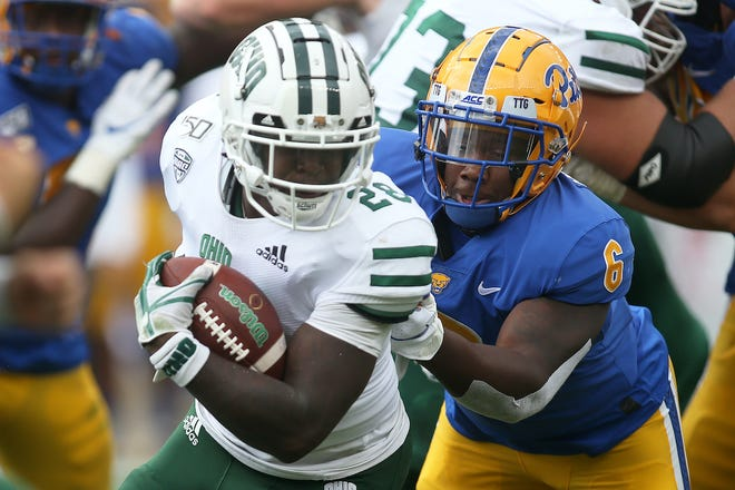 Ohio running back O'Shaan Allison (28) runs the ball against Pittsburgh defensive lineman John Morgan (6) during the teams' game in September.