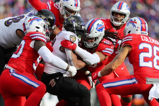 ORCHARD PARK, NEW YORK - DECEMBER 08: Tremaine Edmunds #49 of the Buffalo Bills tackles Mark Ingram II #21 of the Baltimore Ravens during the first half in the game at New Era Field on December 08, 2019 in Orchard Park, New York. (Photo by Brett Carlsen/Getty Images)