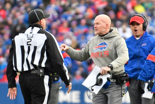Dec 8, 2019; Orchard Park, NY, USA; Buffalo Bills head coach Sean McDermott argues with line judge Bart Longson (2) about the Baltimore Ravens having twelve men in the huddle in the first quarter at New Era Field. Mandatory Credit: Mark Konezny-USA TODAY Sports